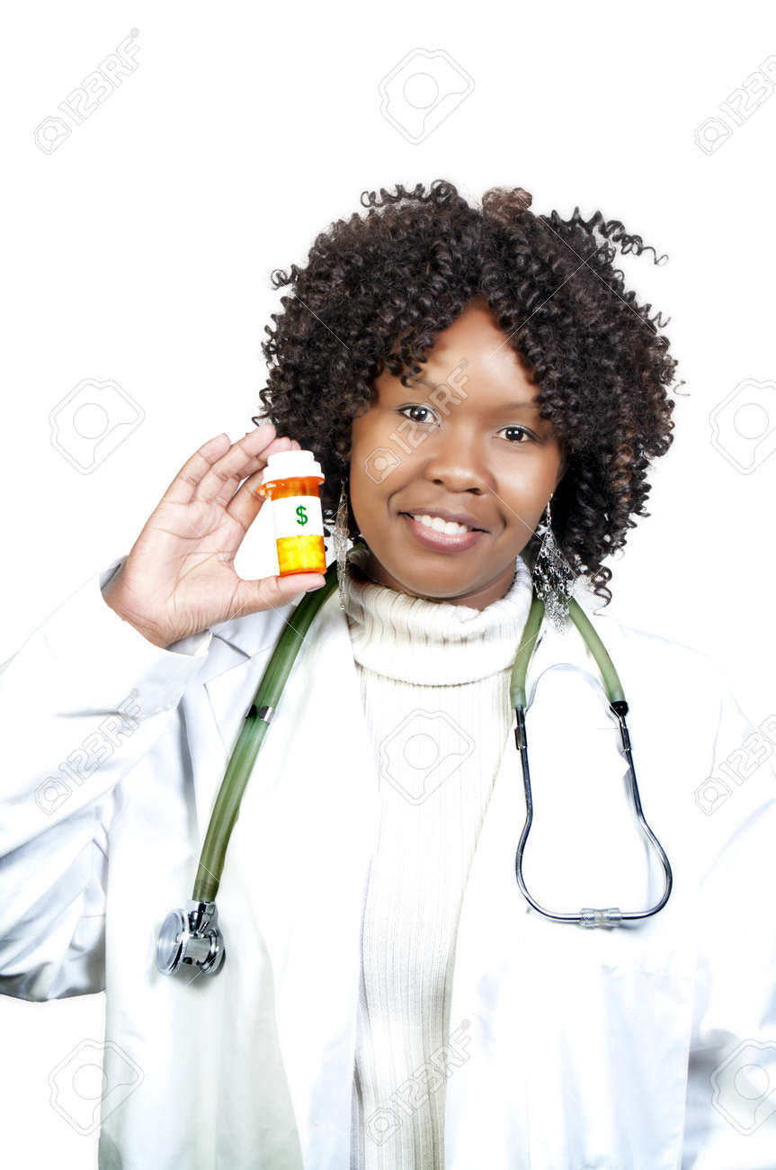 An doctor holding a bottle of prescription medication Stock Photo - 8046559