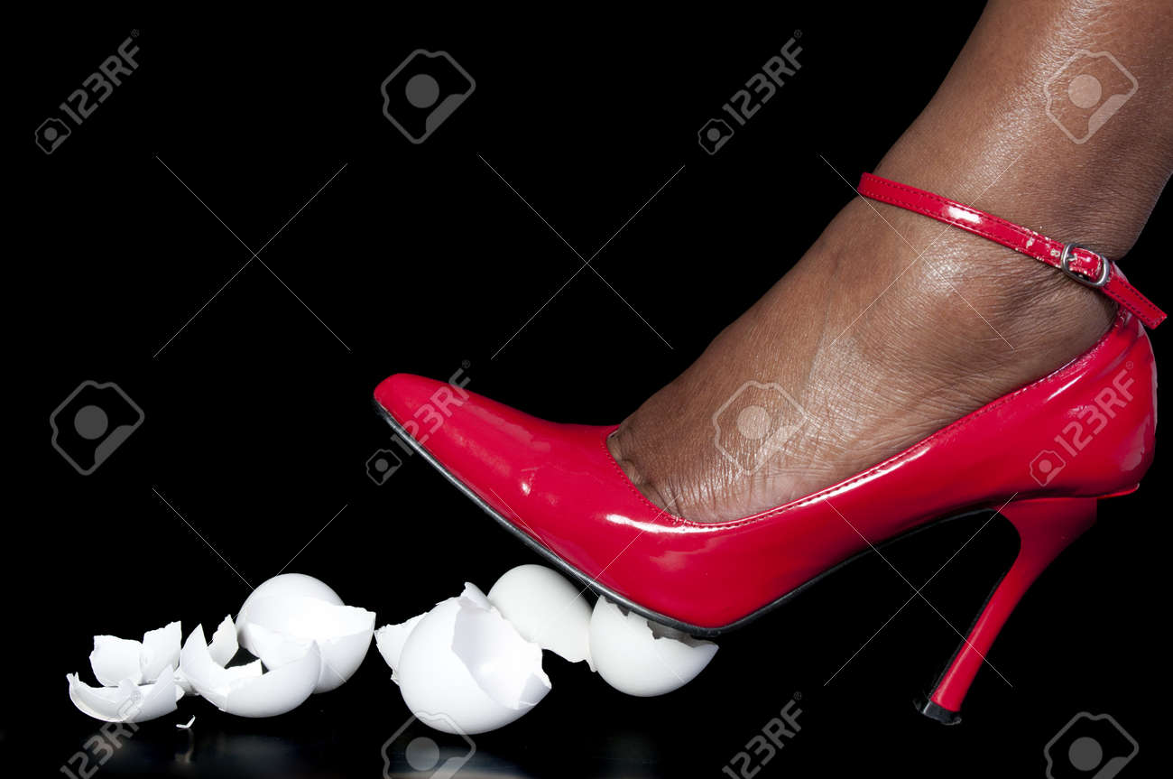 A woman in high heels walking on eggshells Stock Photo - 8175611
