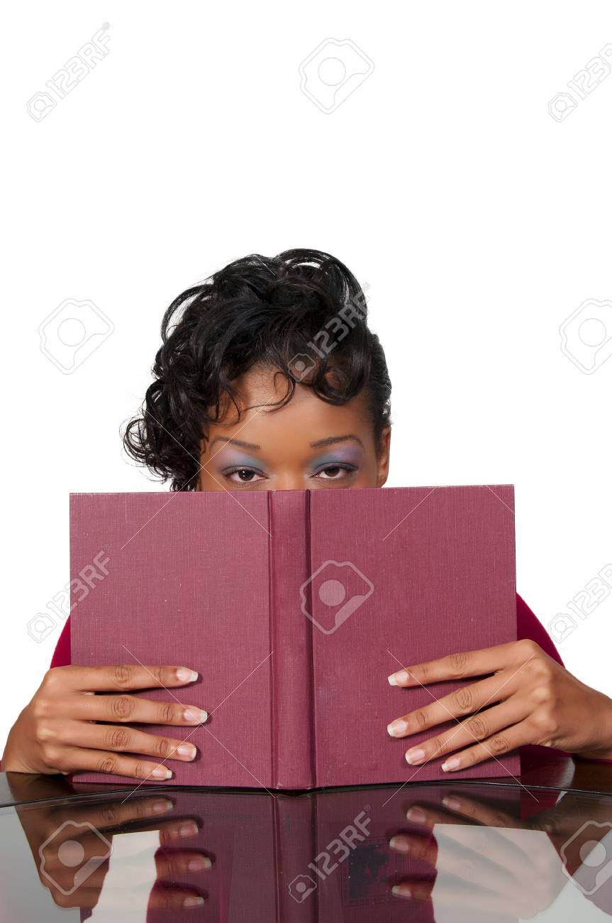 A young African American woman reading a book Stock Photo - 8429962