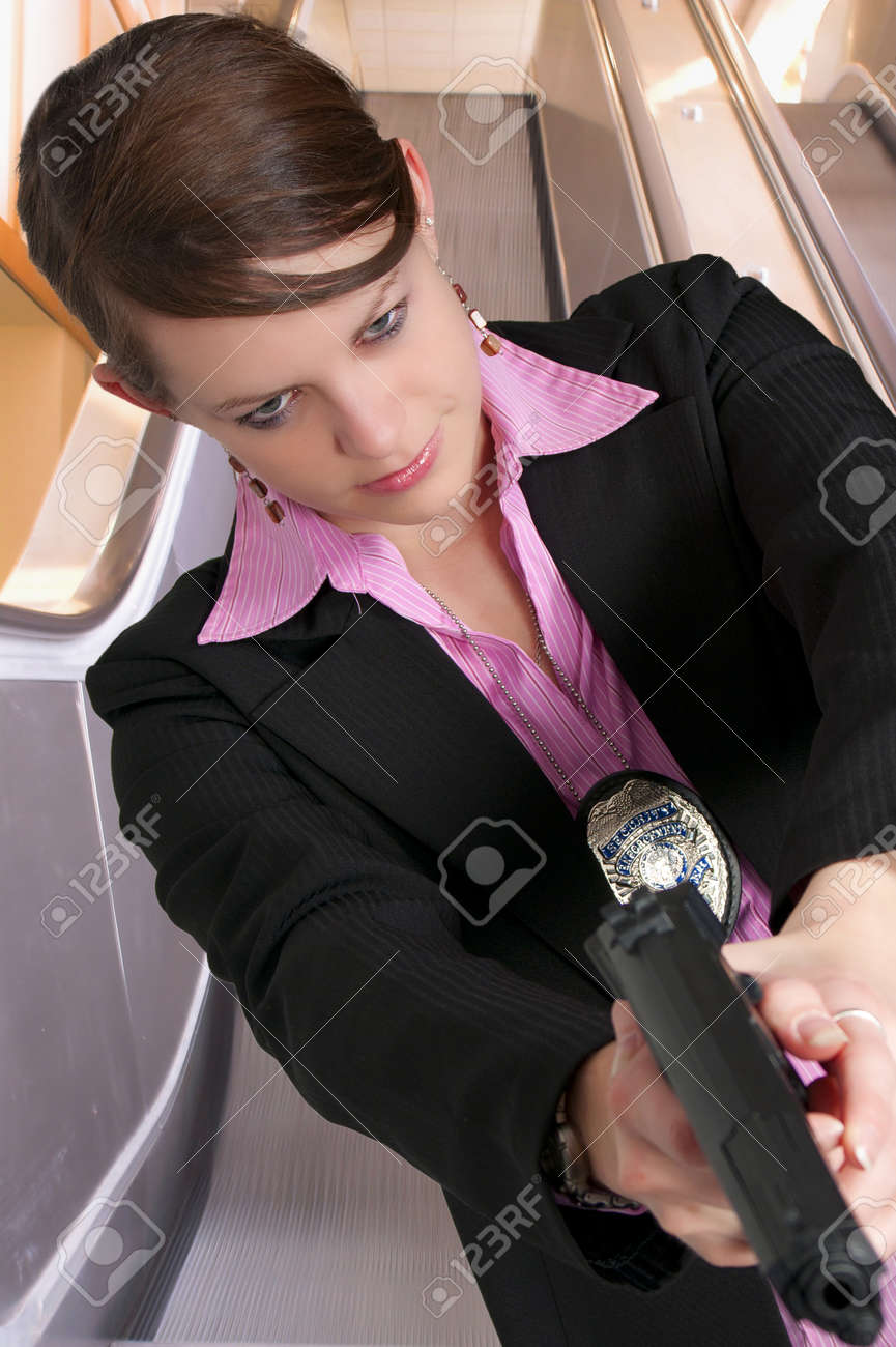 A beautiful police detective woman on the job with a gun Stock Photo - 8672090