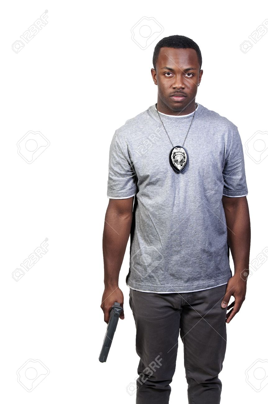 A black African American police detective man on the job with a gun Stock Photo - 8672886
