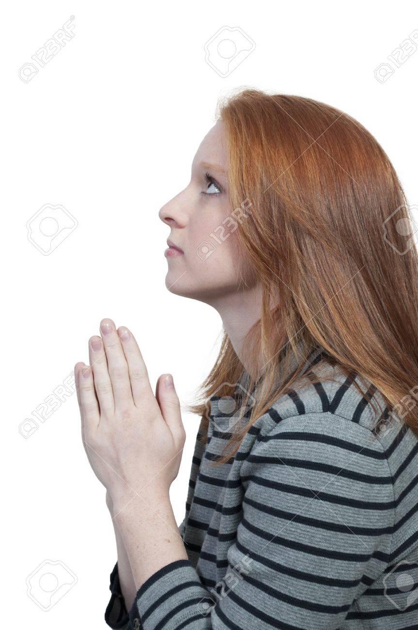 Beautiful Christian woman in a deep prayer Stock Photo - 9587560