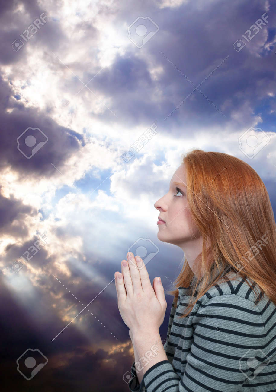 Beautiful Christian woman in a deep prayer Stock Photo - 9581556
