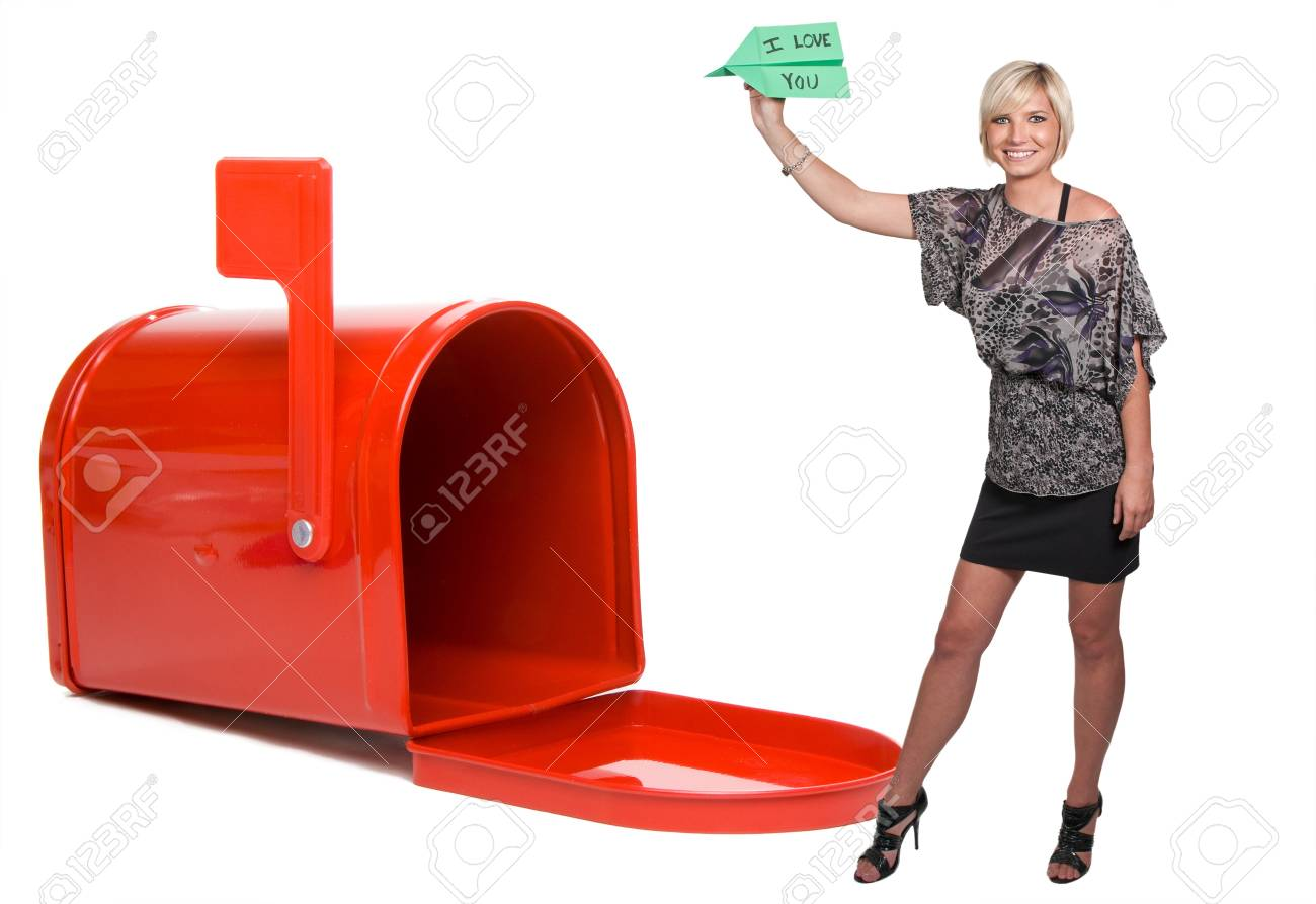 A woman throwing a paper airplane that says I Love You Stock Photo - 11171606