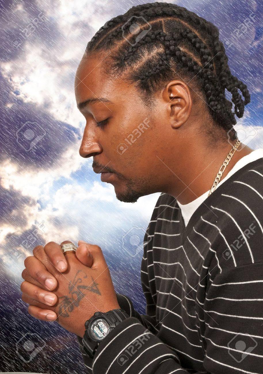 Black African Americanl Christian man in deep prayer Stock Photo - 12550405