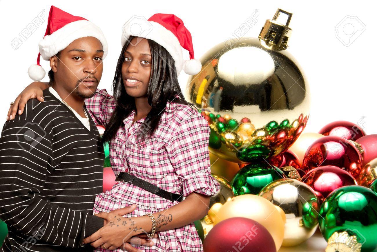 A beautiful young black couple wearing Christmas Santa Hats Stock Photo - 14880687