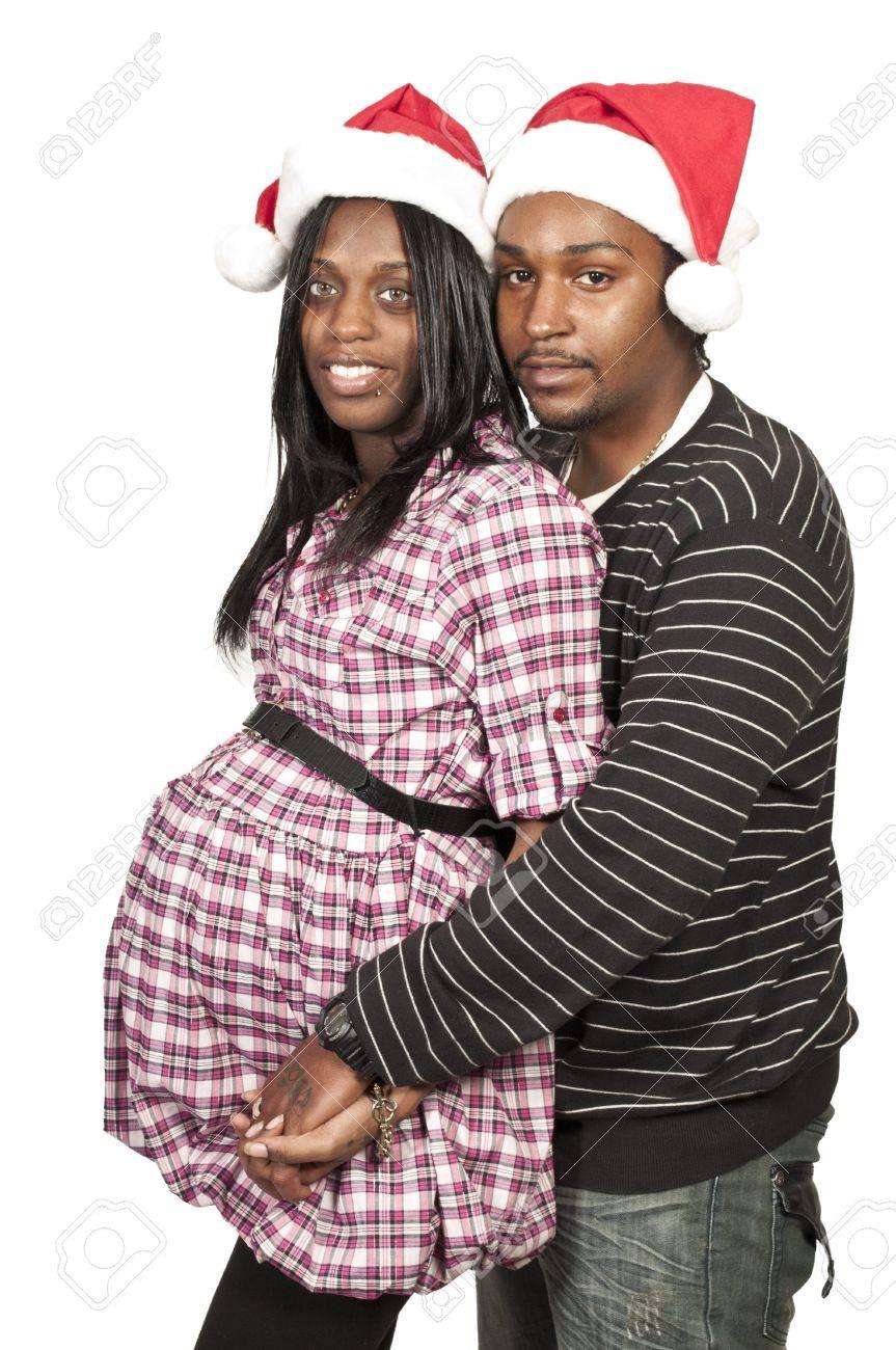 A beautiful young black couple wearing Christmas Santa Hats Stock Photo - 12550479