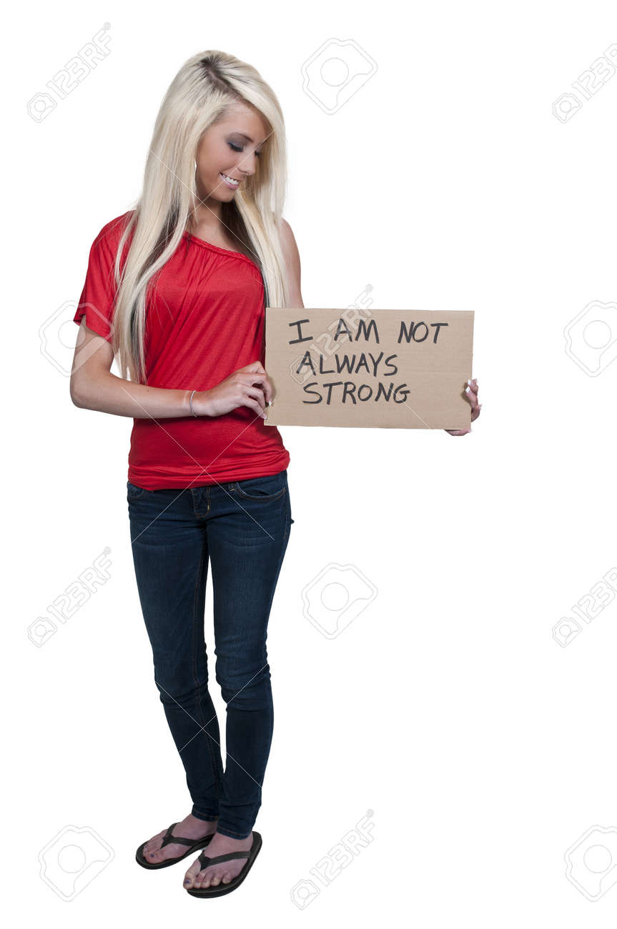 A beautiful young woman holding up a siagn that says I am not always strong Stock Photo - 12319961