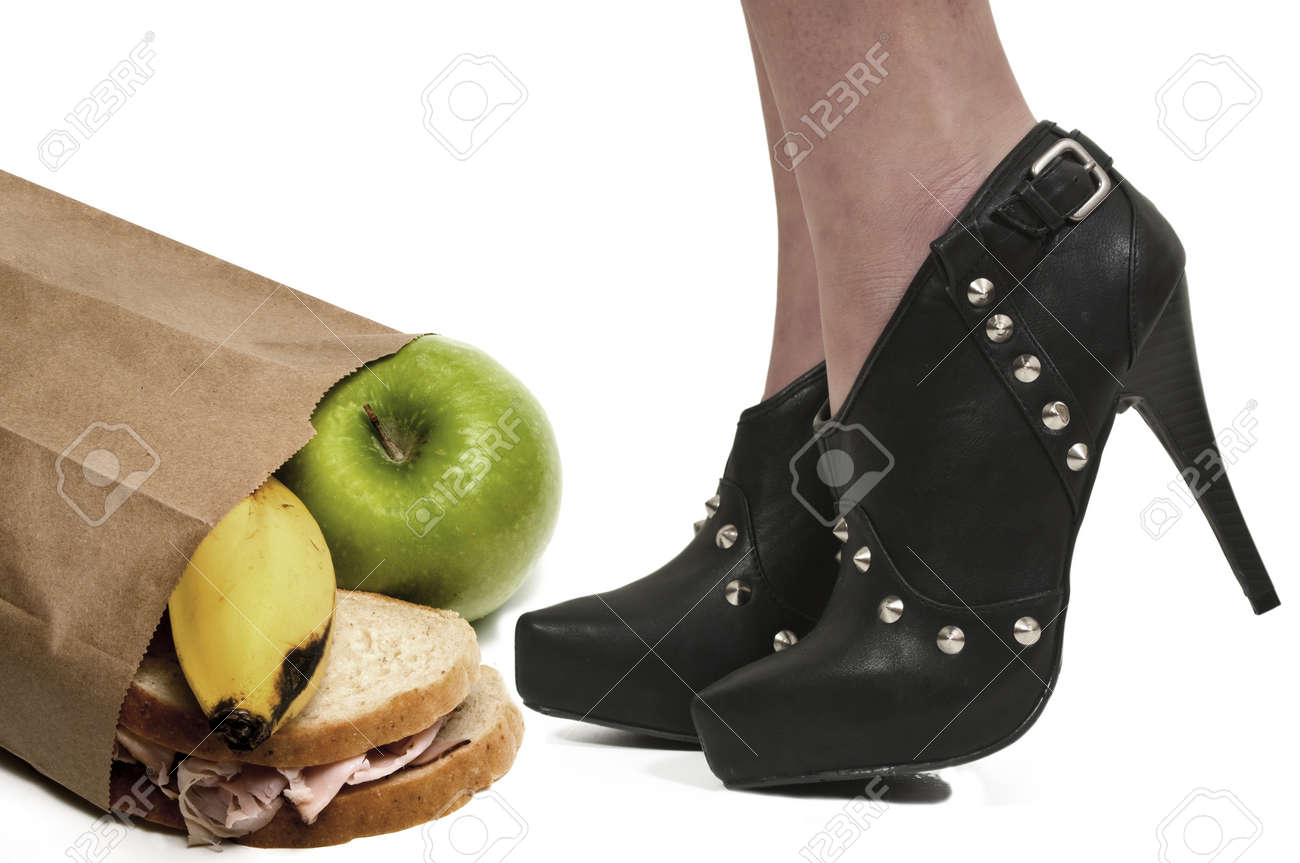 A woman wearing sexy high heeled pumps shoes with her lunch Stock Photo - 12549256