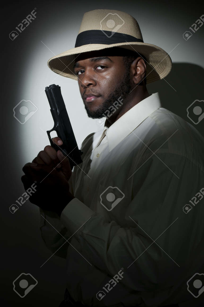Black African American police private detective man on the job with a gun Stock Photo - 13545085