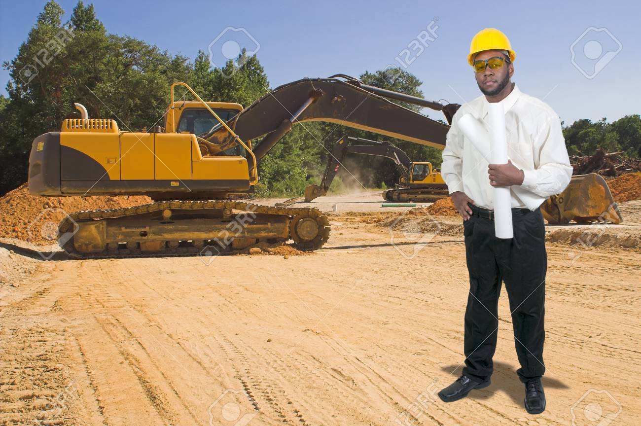 Balck African American male construction worker a job site with a backhoe Stock Photo - 13545140