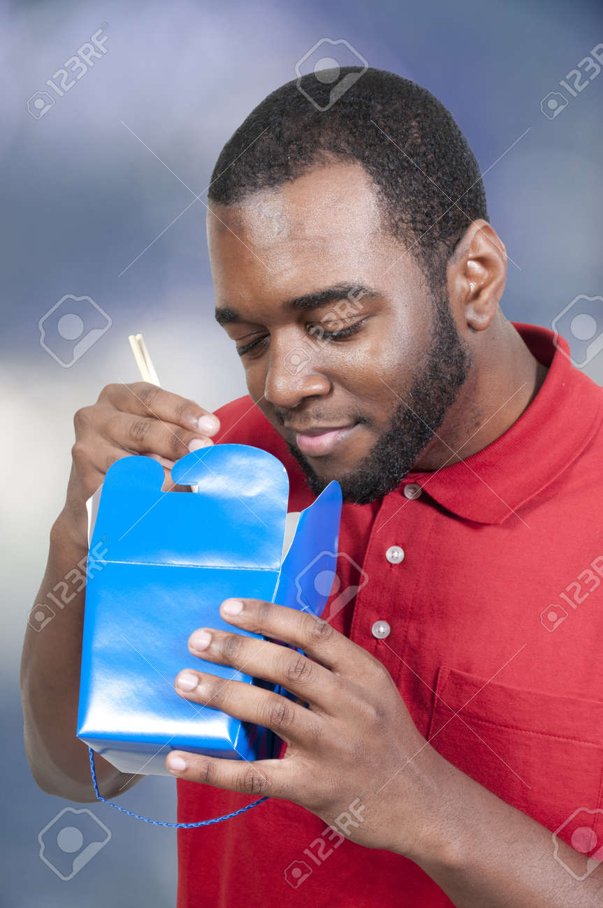 Black African American man eating Chinese or Japanese Asian food Stock Photo - 13545360