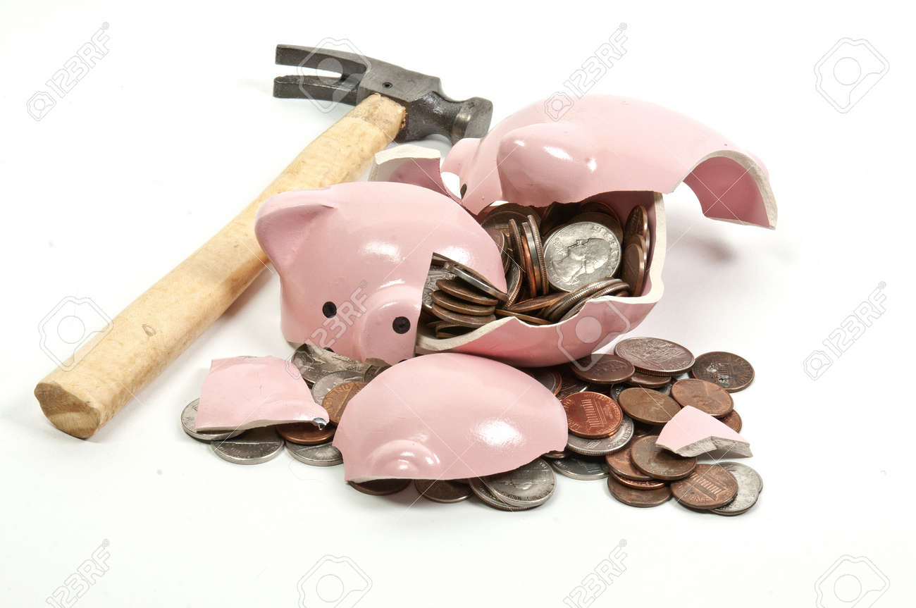Broken Piggy Bank Filled With Loose Change Stock Photo, Picture ...