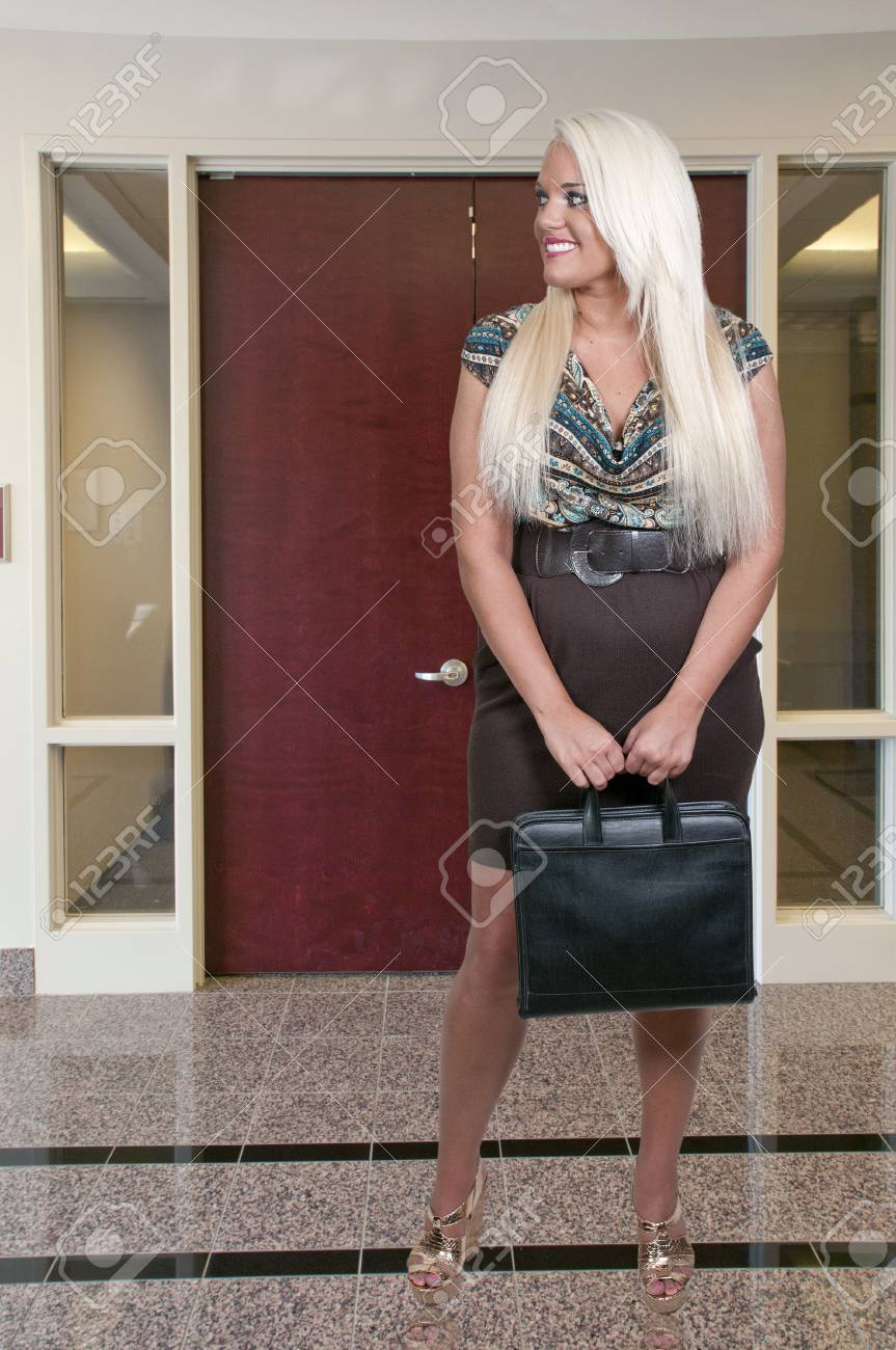 A beautiful young upwardly mobile business woman Stock Photo - 14879241
