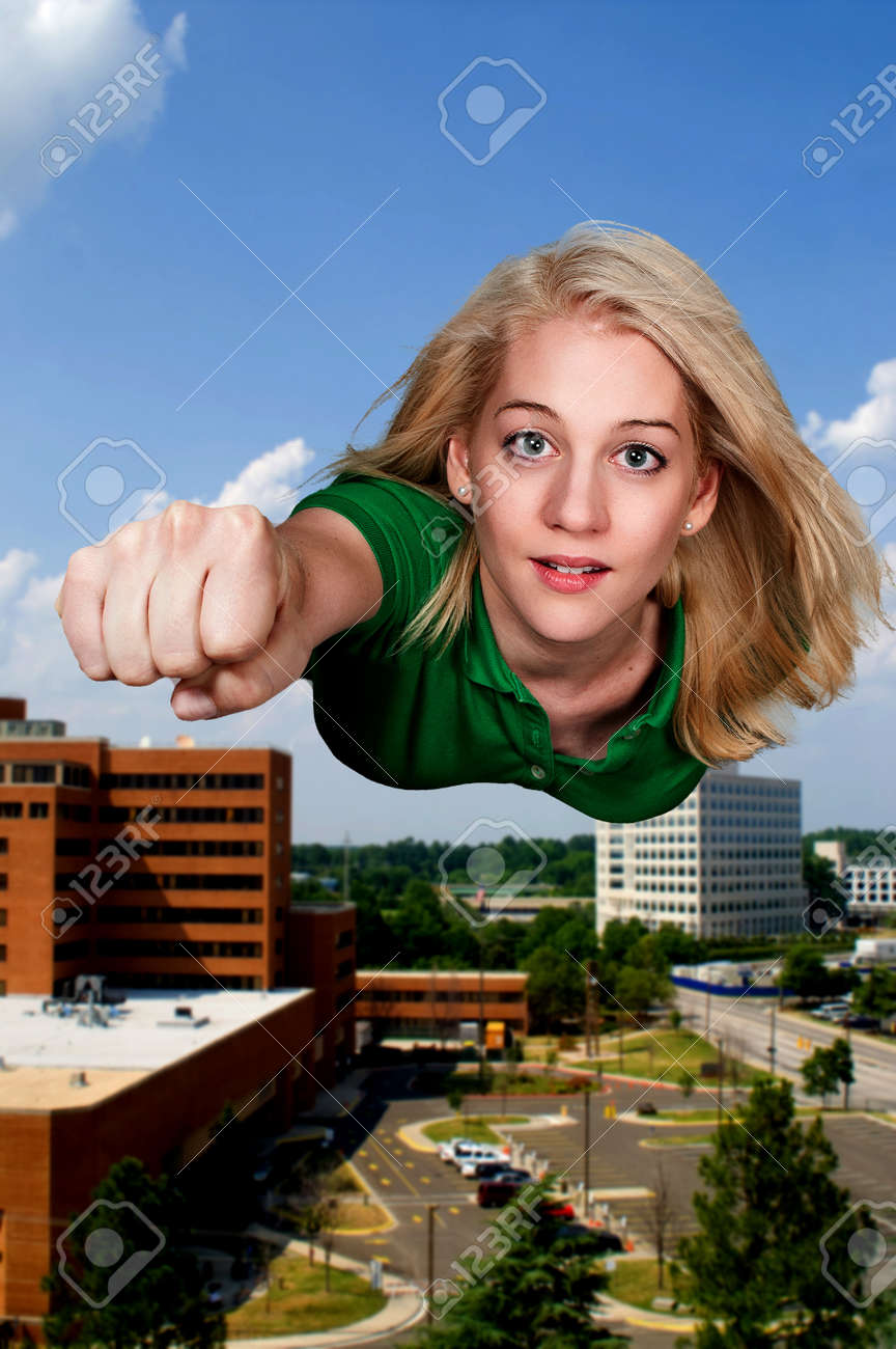 Beautiful woman super hero flying through the sky Stock Photo - 14879676