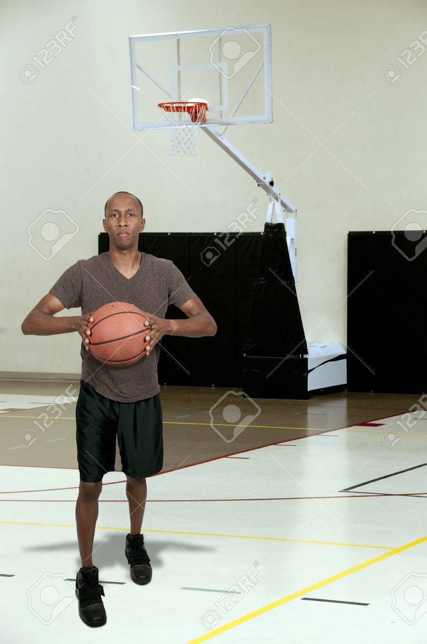Handsome black African American man playing basketball Stock Photo - 15646757
