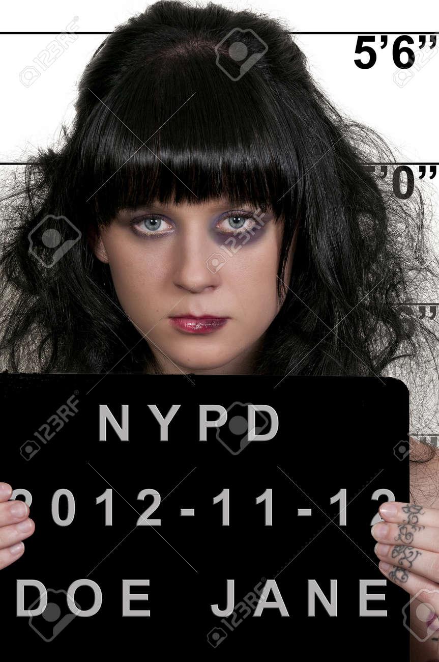 Mugshot of a beautiful young woman criminal Stock Photo - 16717514