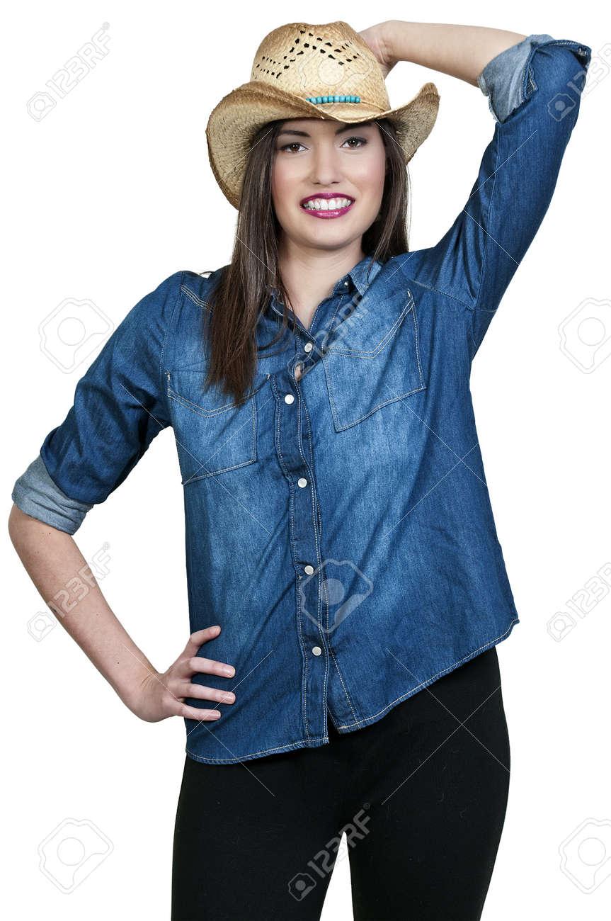 Beautiful young country girl woman wearing a stylish cowboy hat Stock Photo - 16717584