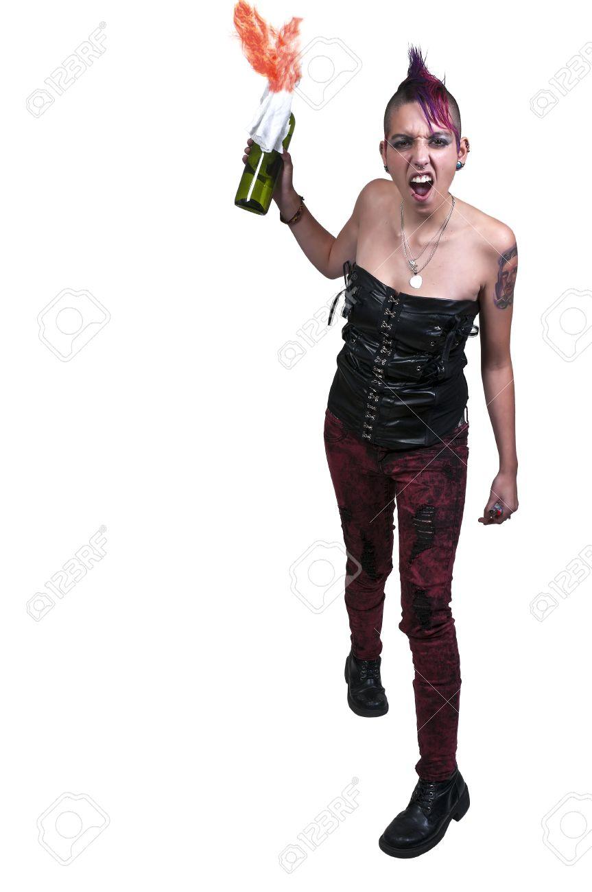 Beautiful rebellious punk rock woman throwing a molotov cocktail Stock Photo - 17425595