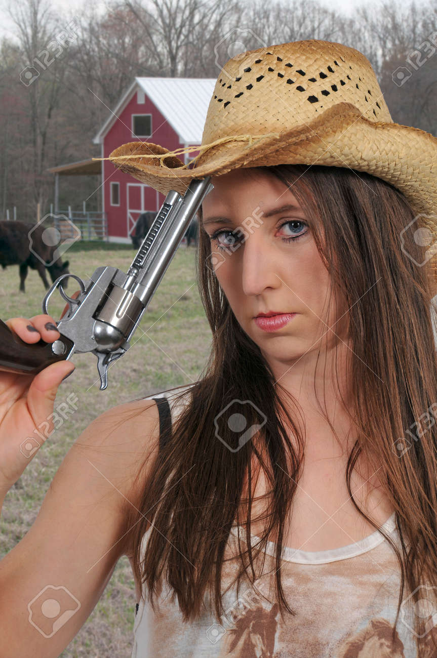 946ebbdf345 Beautiful young country girl woman wearing a stylish cowboy hat..