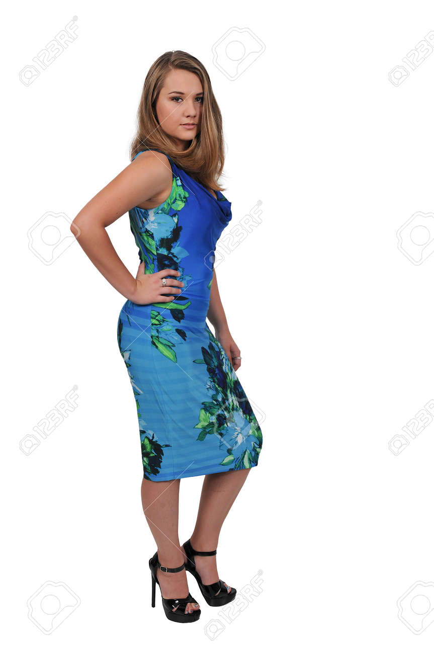 Beautiful young attractive teenage woman modeling her dress