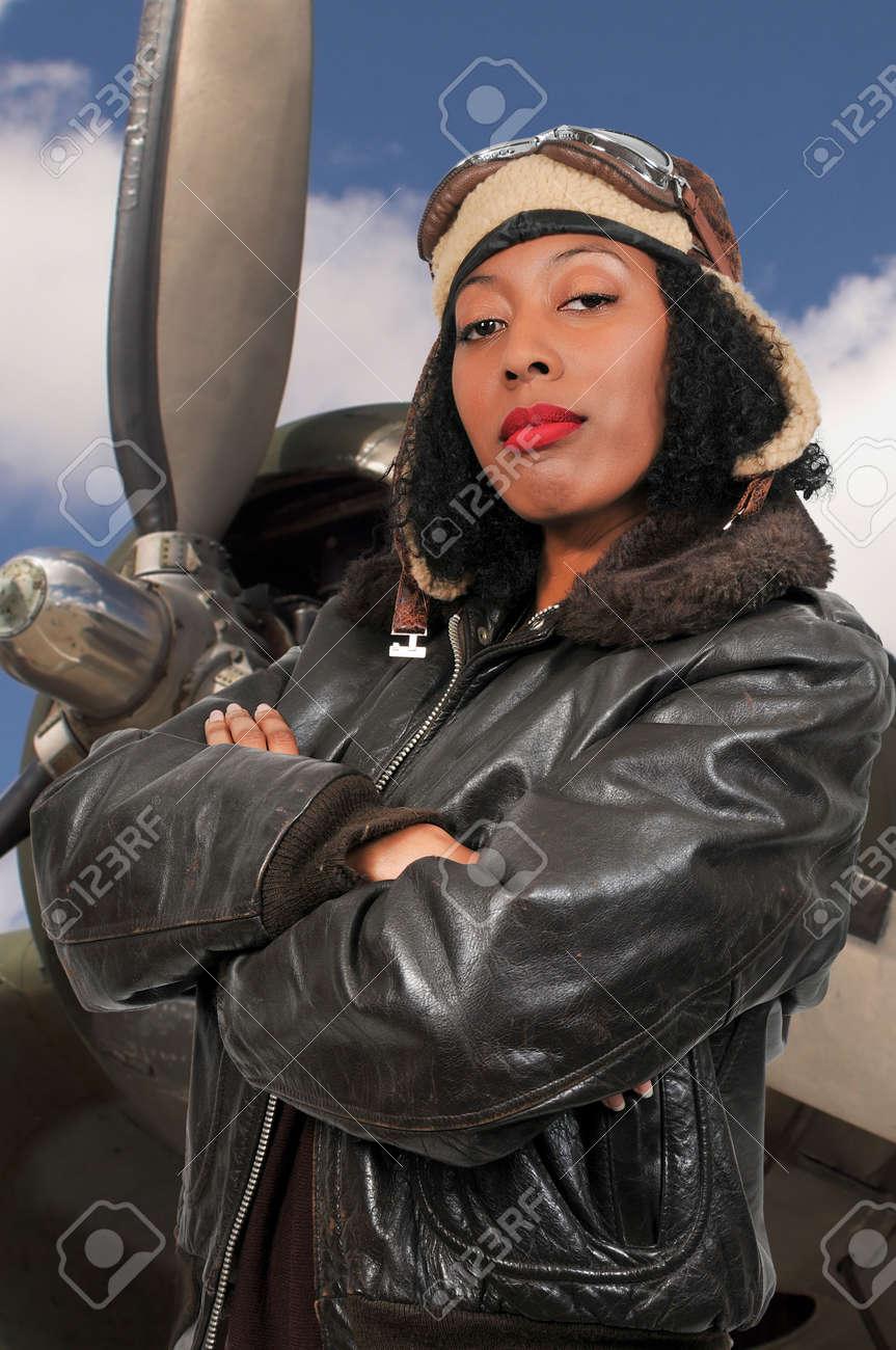 Stock Photo - Woman pilot wearing vintage pilot helmet flight jacket and  goggles