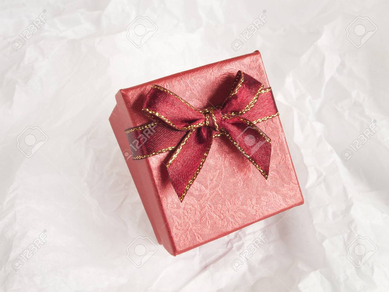 red gift box on abstract white background Stock Photo - 16514948