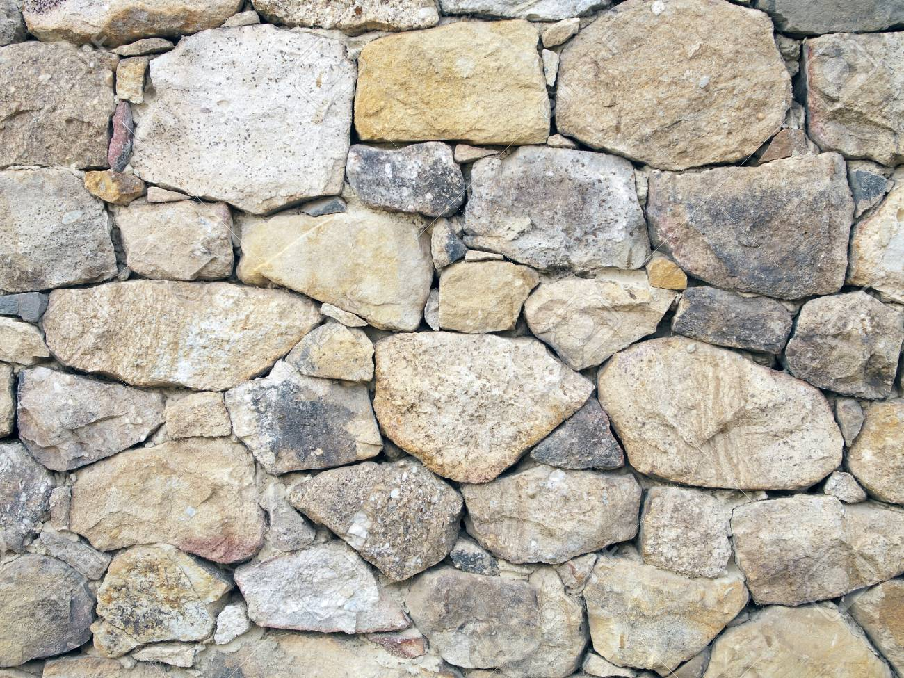 Rustic wall of stones of different sizes Stock Photo - 17788215