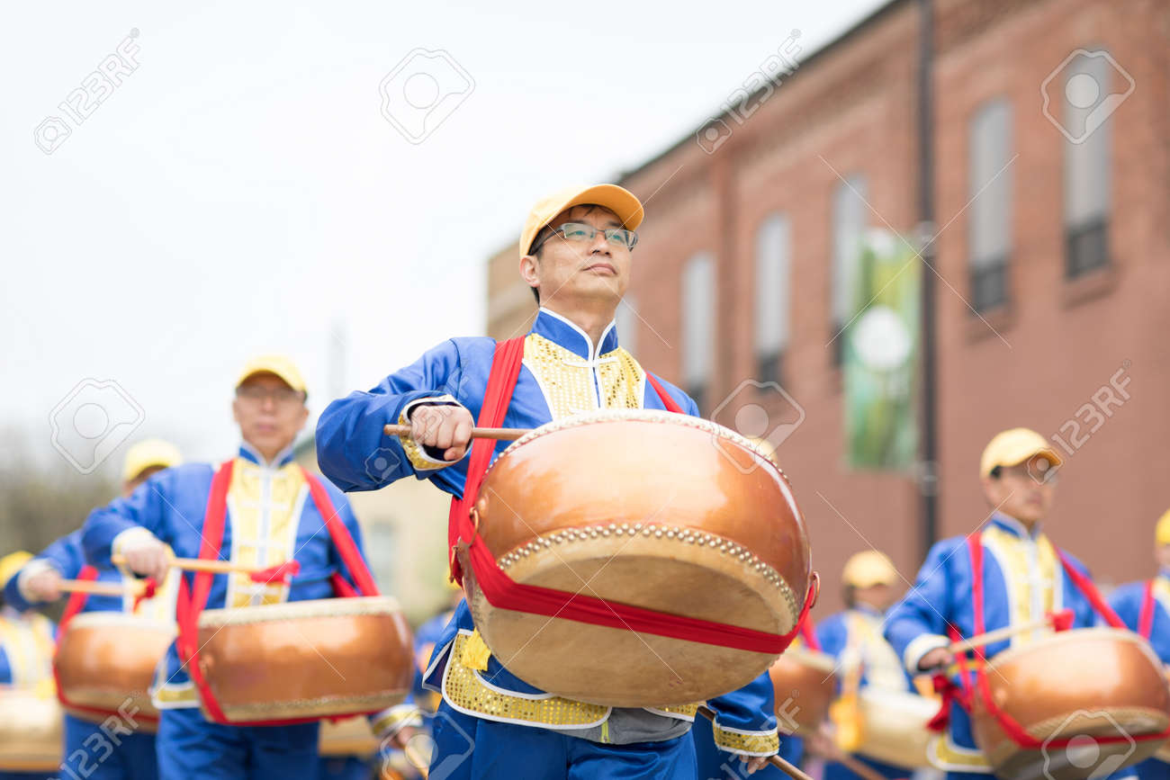 Holland, Michigan, USA - May 12, 2018 Chinese drummers promoting