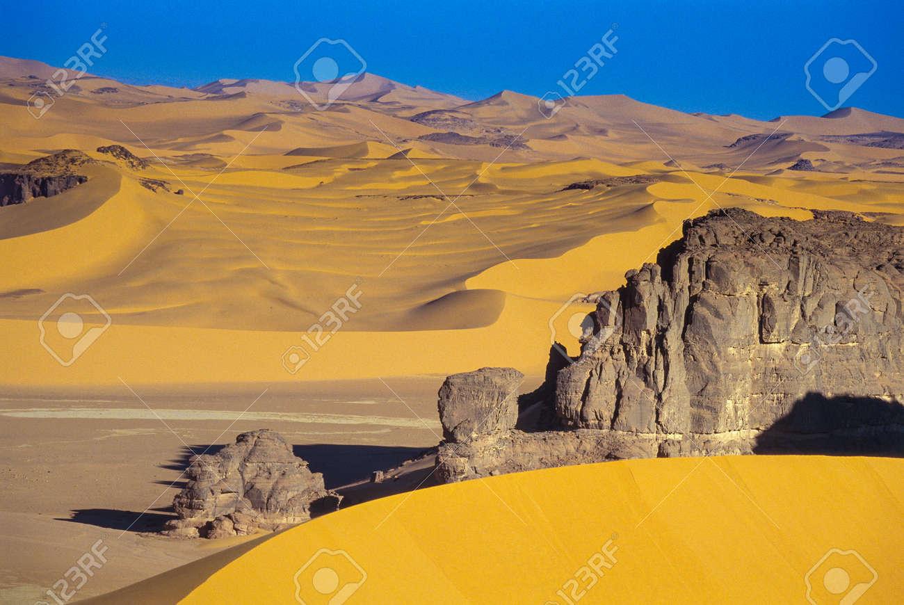 Africa, Algeria, Sahara, Tassili N'Ajjer National Park, Tadrart, rock towers and sand dunes - 123021548