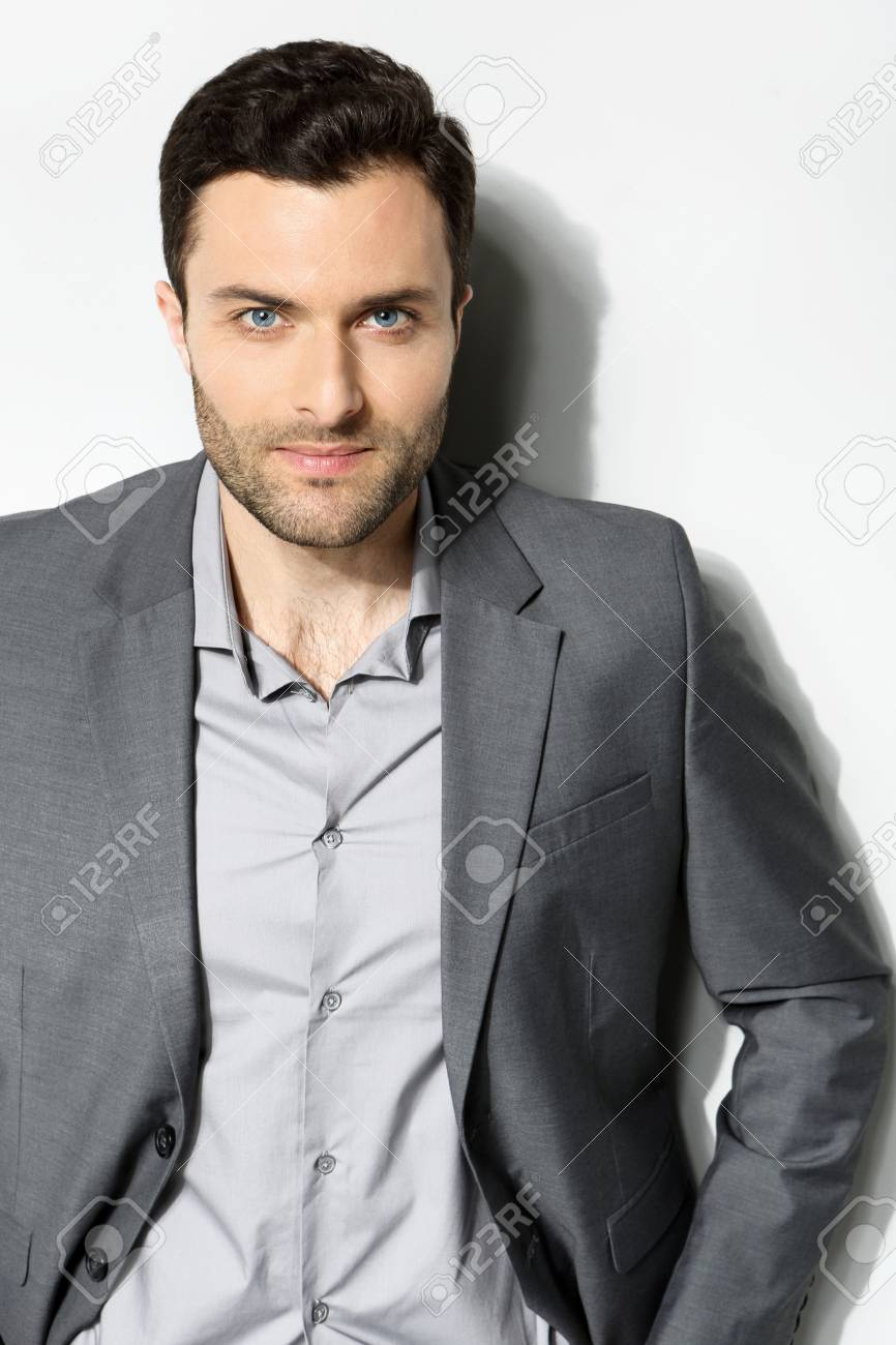 Young stylish man on a gray background Stock Photo - 18462318