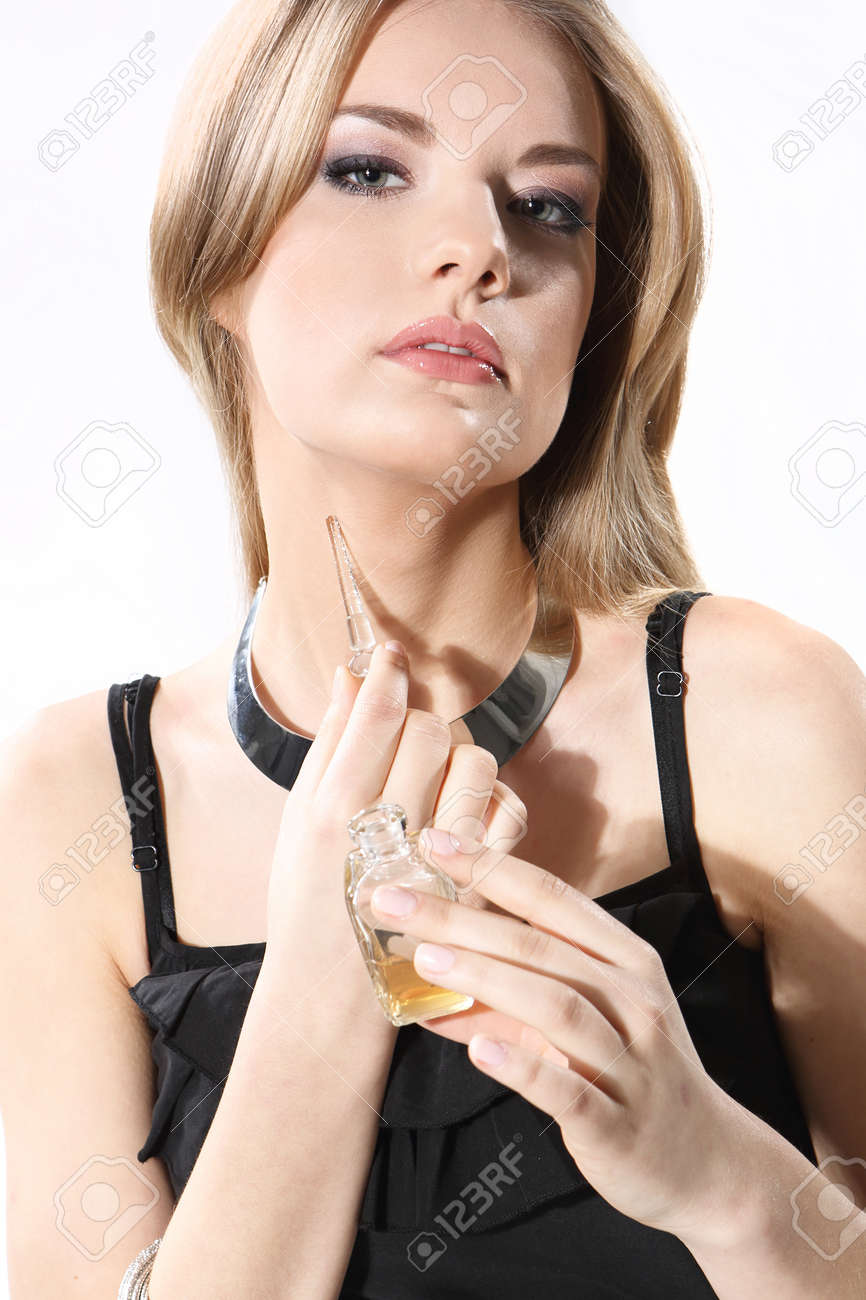 Beautiful girl with perfume on a white background Stock Photo - 18461372