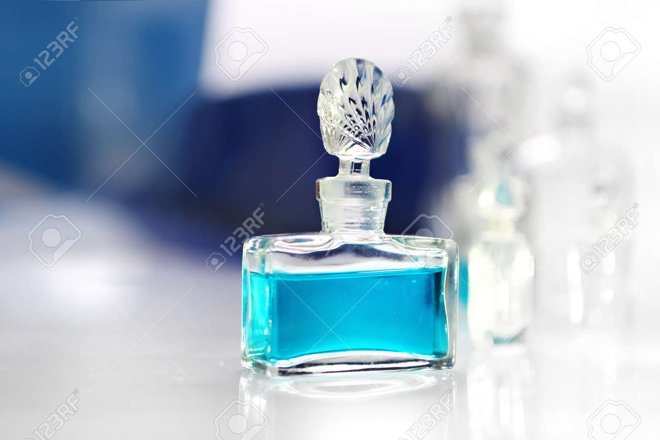 Perfume with beautiful bottle on the table Stock Photo - 18517324