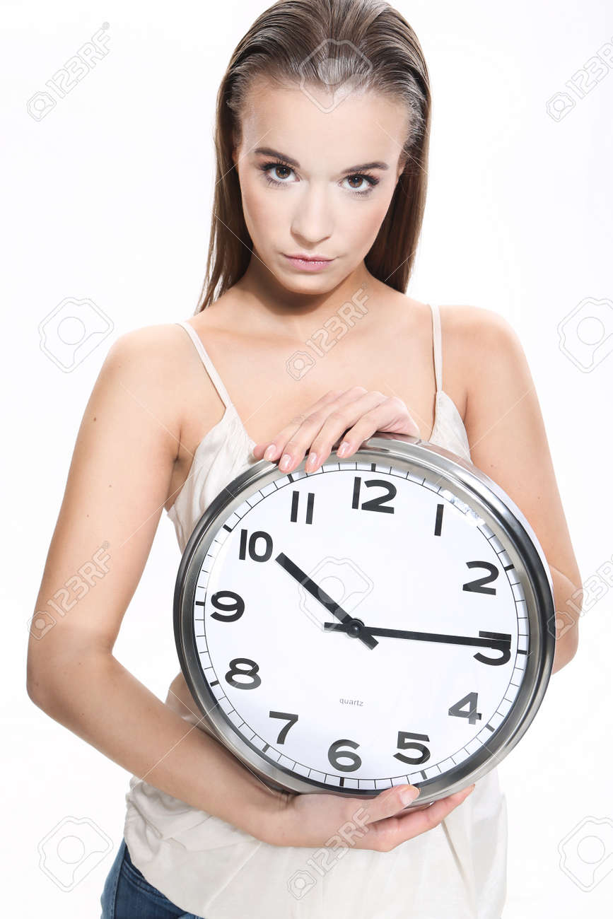 Girl with a clock on white background Stock Photo - 18498135