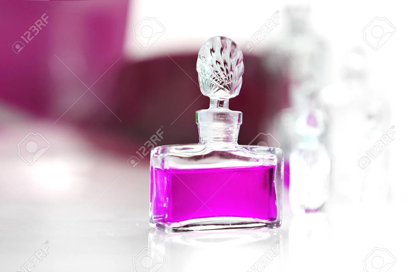 Perfume on a white table Stock Photo - 18517313