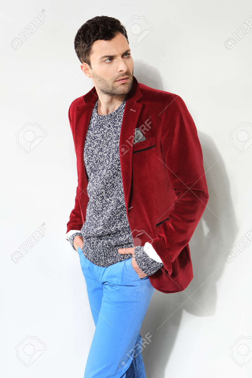 Handsome man posing in a red jacket Stock Photo - 18521709