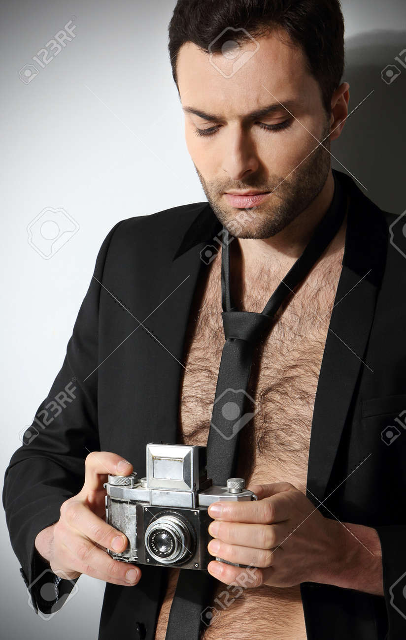 Attractive man taking photo Stock Photo - 18521743
