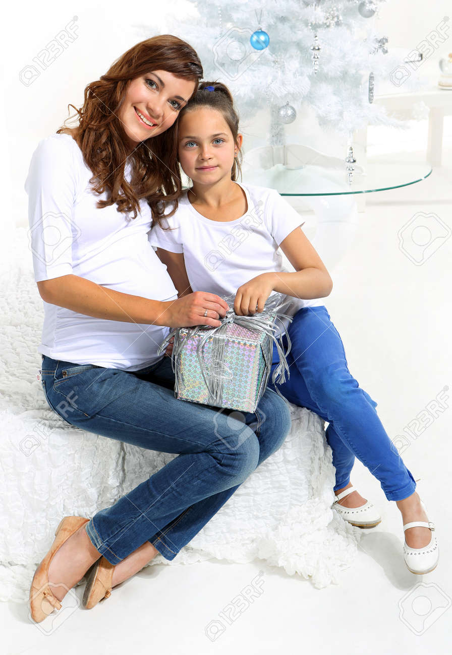 Mom and daughter  with Christmas gift Stock Photo - 22419198