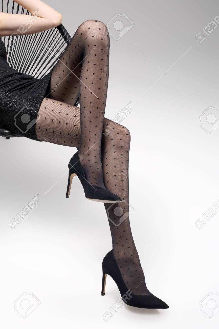 1b0d1b236 Stock Photo - Tights. Shapely female legs in black tights and high heels.