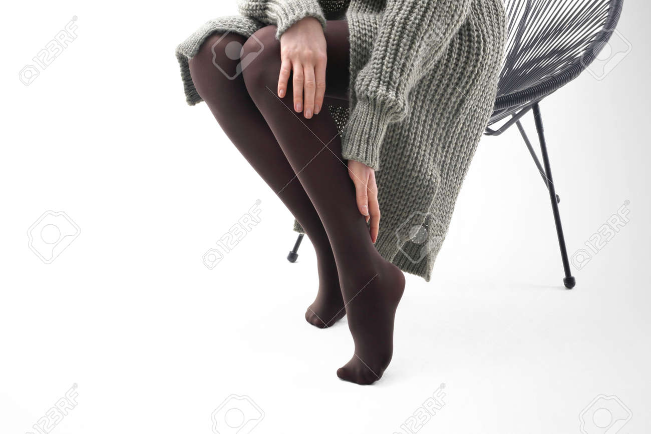 399b23c70 Brown tights. shapely legs of a woman in opaque tights. Stock Photo -  92762300