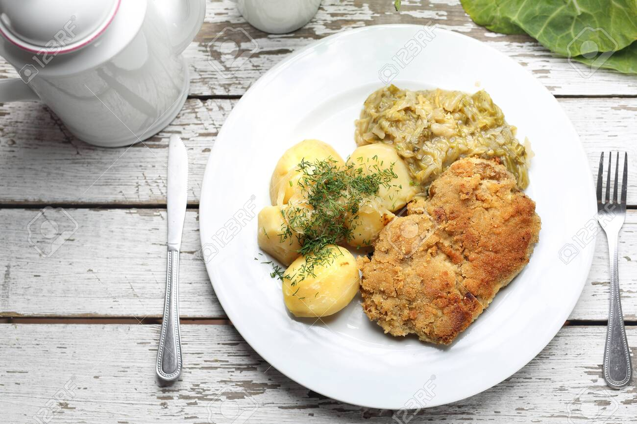 Traditional Polish cuisine, pork chop with potatoes and fried cabbage. - 123712722