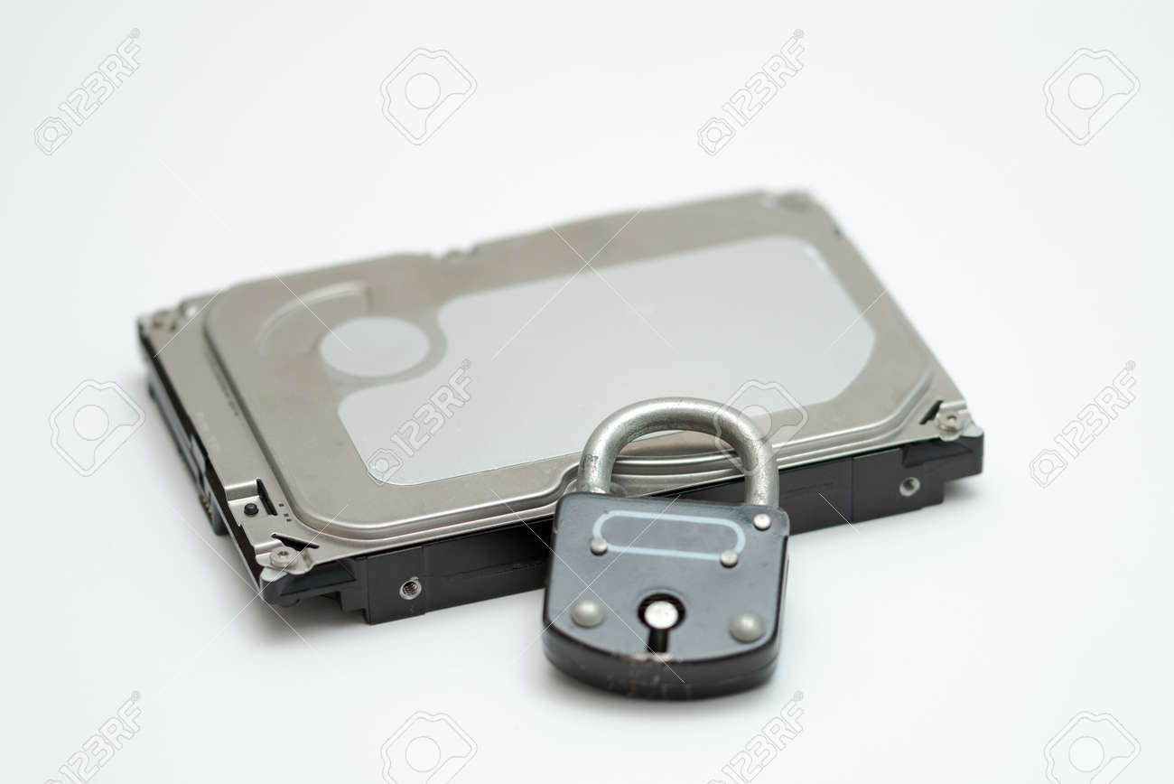 Computer hard disk and metal padlock symbolizing concept for encrypted data, cyber security - 162314752