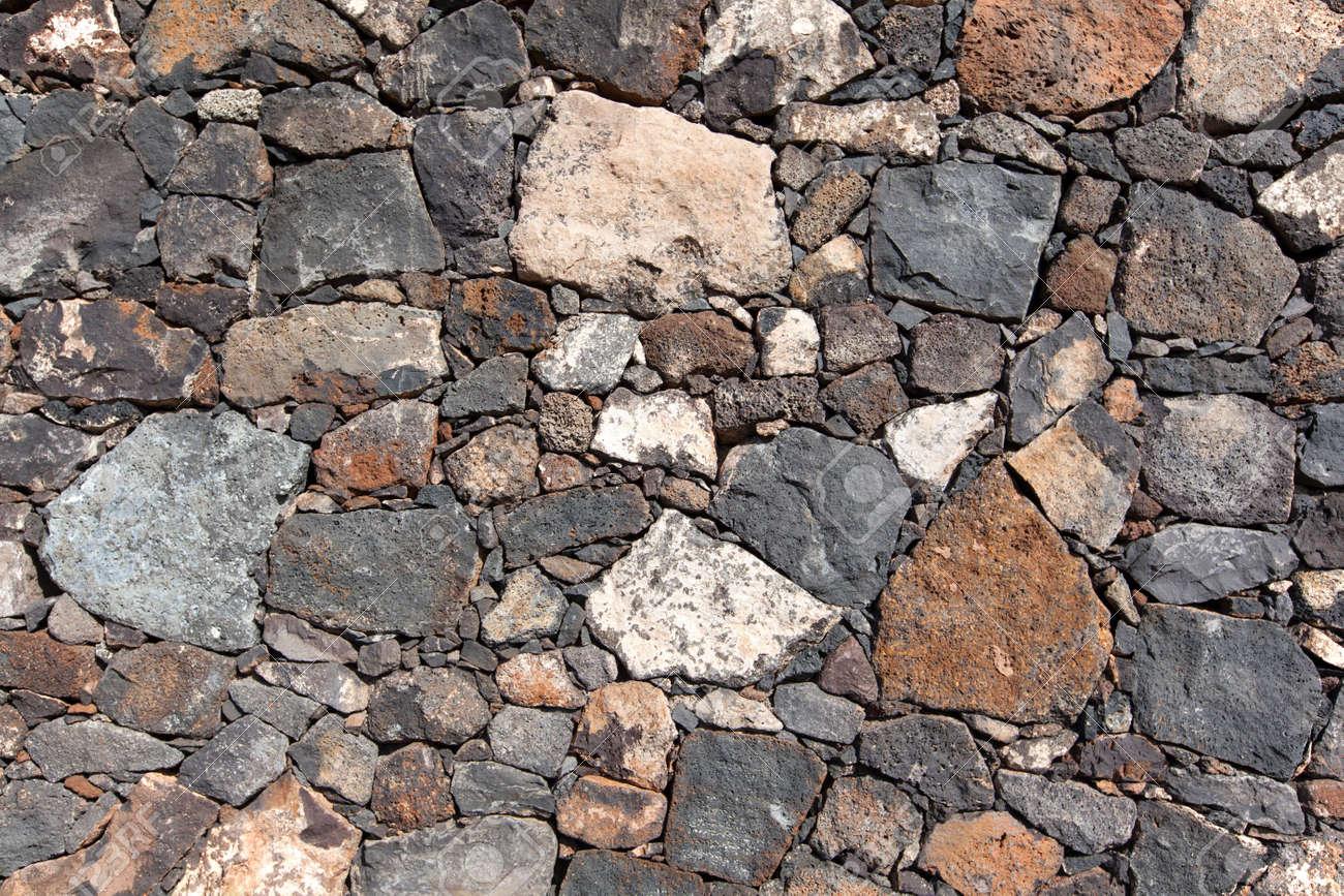 Mur En Pierre Naturelle détail tiré d'un mur en pierre naturelle des canaries avec des pierres  multicolores, prises à lanzarote, îles canaries, espagne.