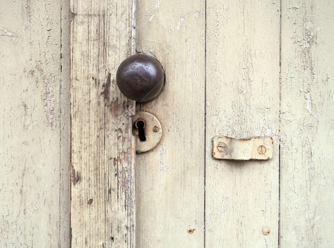 Old Lock With A Round Door Knob On A Weathered, Beige Wooden.. Stock ...