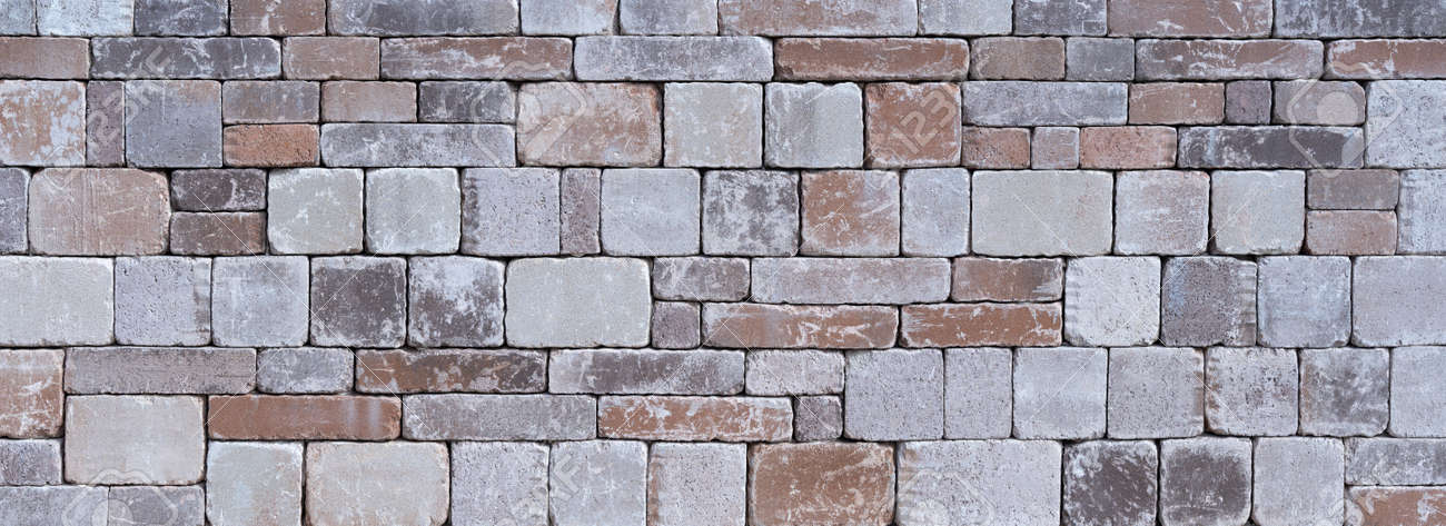 Stone wall made of different square natural stones - 132051369