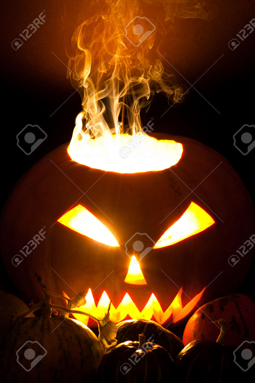 Smoky Halloween Pumpkin Jack O Lantern And Small Pumpkins In Stock Photo Picture And Royalty Free Image Image 7883977