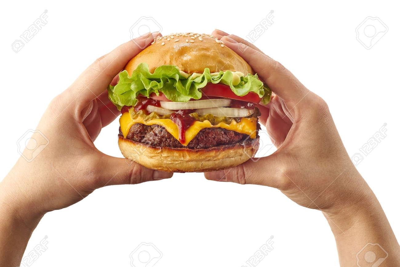 Hands holding hamburger on white - 141251134