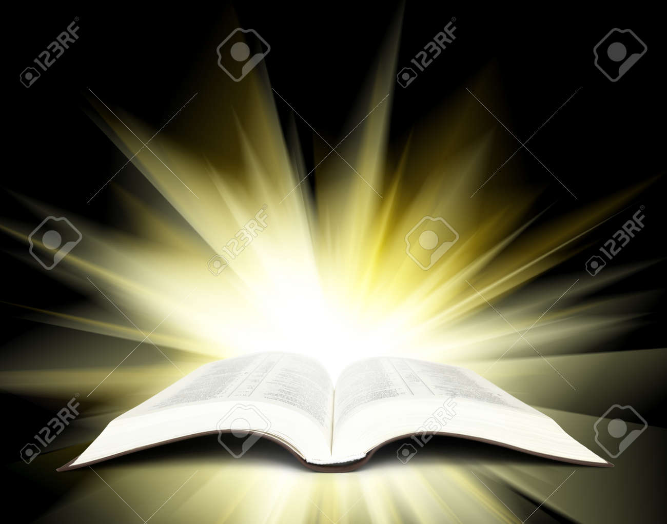 open bible with yellow rays of light stock photo picture and