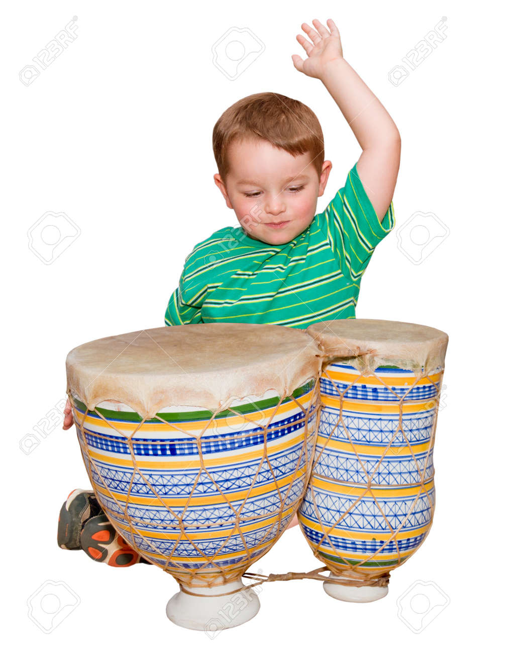 Young boy plays African bongo tom-tom drums, isolated on white background Stock Photo - 9747812