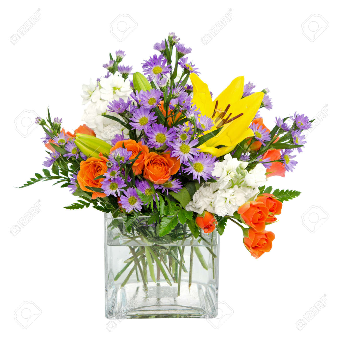 Colorful flower arrangement centerpiece in square glass vase stock colorful flower arrangement centerpiece in square glass vase with roses daisies and llilies isolated on izmirmasajfo